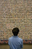 New York City. Man looking a pictures of victims of the 2001 terrorist attacks on the Twin Towers at the National 9/11 Memorial Museum at Ground Zero royalty free stock image