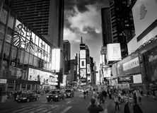 NEW YORK CITY, MANHATTAN, APR,24, 2015: Balck and white NYC Times Square lights screens buildings fashion boutiques led billboards Royalty Free Stock Photo