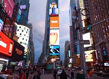 NEW YORK CITY, MANHATTAN, APR,24, 2015: Evening view on NYC Times Square lights and led screens on buildings, fashion boutiques, l stock images