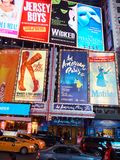 NEW YORK CITY, MANHATTAN, APR,24, 2015: Evening view on NYC Times Square lights and led screens on buildings, fashion boutiques, l royalty free stock image