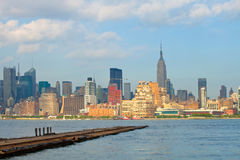 New York City, Manhattan buildings view. From the Harbor on Hudson river, with blue sky and clouds Royalty Free Stock Images