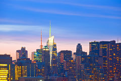 New York City, Manhattan downtown. Financial business buildings closeup at sunset Stock Images