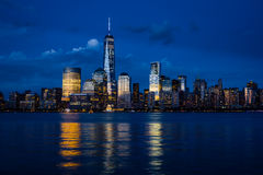 New York City Manhattan Downtown Skyline With Skyscrapers Illuminated Over Hudson River Panorama Stock Photography