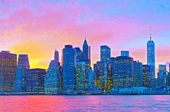 New York CIty, Manhattan. Famous landmark buildings of financial district at colorful sunset Royalty Free Stock Photos