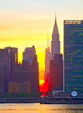 New York City, Manhattan famous landmark buildings. Skyline in downtown at beautiful colorful sunset with reflections Royalty Free Stock Photos