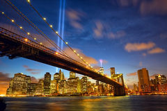 New York City Manhattan in memory of September 11. Lower Manhattan skyline with Brooklyn Bridge and the Towers of Lights (Tribute in Light) in New York City Royalty Free Stock Image
