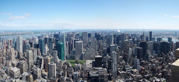 New York City skyline panorama Manhattan midtown. Aerial view with skyscrapers and blue sky in the day stock image