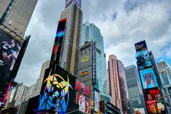 NEW YORK CITY, MANHATTAN, OCT,25, 2013: NYC Times Square screens and lights on buildings, fashion boutiques architecture and adver stock photography