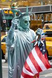 NEW YORK CITY, MANHATTAN, OCT,25, 2013: View of man in live sculpture suit of New York city Statue of Liberty with American flag a stock image