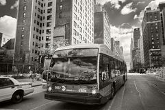 NEW YORK CITY, MANHATTAN, OCT. 25, 2013: View on NYC bus and cars on the road with different buildings, skyscrapers in the backgro. Und. City road traffic. Black royalty free stock photos