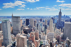 New York City Manhattan panorama. New York City Manhattan midtown aerial panorama view with skyscrapers and blue sky in the day Royalty Free Stock Photos