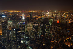 New York City Manhattan  panorama. Aerial view at night with office building skyscrapers skyline Royalty Free Stock Photography