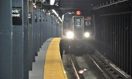 New York Subway and Car. New York City Manhattan Subway Car entering Vector Street Station Stock Photos