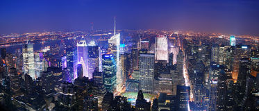 New York City Manhattan Times Square skyline. Aerial view panorama at night with skyscrapers and street stock images