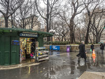 New York City Manhattan Union Square. New York City,Manhattan News stand on Union Square during rain storm 2/16/2016, 12:31:58 PM with people walking in rain Stock Photography