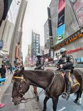 NEW YORK CITY - MAR 10: Mounted Police on Times Square, March 10. 2010 in New York City. Horse Police is employed in crowd control because of their mobile mass Royalty Free Stock Photos