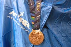 2017 New York City Marathon finisher medal in Manhattan royalty free stock images
