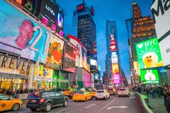 Times Square area with neon art and commerce stock photos