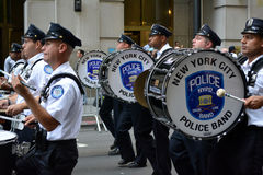 New York City. Members of the NYPD band marching down Broadway in a procession marking the anniversary of the terrorist attacks at the World Trade Center royalty free stock photography