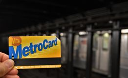 New York City Metrocard with Subway Train Tracks in the Background Metro Card Closeup stock photos