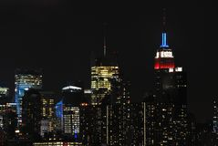 New York City Midtown at Night. Showing Empire State Building in red white and blue, the midtown area, including the glow from Times Square Royalty Free Stock Photography