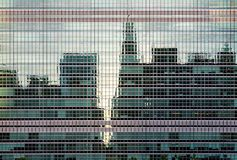 New York City midtown skyline reflected in the glass windows. Of the UN building in Manhattan royalty free stock images