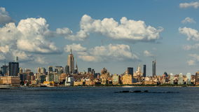 New York City Midtown West skyscrapers, West Village and Hudson River with passing clouds stock video footage