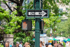 New York City. Moving people under One Way street sign Stock Photo