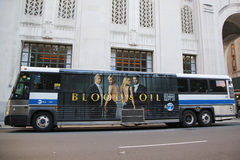 New York City MTA bus with advertisement for Blood and Oil TV series. NEW YORK - OCTOBER 6, 2015: New York City MTA bus with advertisement for Blood and Oil TV Royalty Free Stock Images