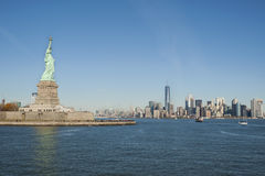 New York City, New York, USA - November 21, 2015. Beautiful view towards iconic Freedom tower and financial district from Upper Bay Hudson River with Statue of royalty free stock image