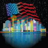 New York City. At night. Buildings that are historical with the US flag behind the buildings Royalty Free Stock Images
