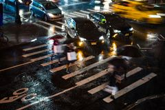 New York City at Night Cross Walk With Time Lapse Motion Blur Royalty Free Stock Image