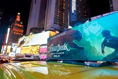New York City at night. NEW YORK - CIRCA MARCH 2016: close up shot of AD on New York taxi at night. The City of New York, often called New York City or simply royalty free stock images
