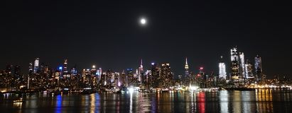 New York City Night Skyline with a Full Moon. This is a panoramic shot on a night from West New York from a cliff stock photos