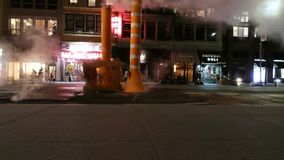 New York City at Night. Traffic and steam pipes on Twenty-Third Street, in Manhattan. The steam system provides heating and hot water to thousands of businesses stock footage
