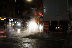 NEW YORK CITY - NOVEMBER 2019: night traffic and smoke in new york royalty free stock image