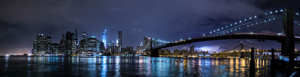 New York City, NY/USA - circa July 2015: Panorama of Brooklyn Bridge and Lower Manhattan by  night Stock Photo