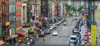 New York City, NY / USA - 08/01/2018: Looking down East Broadway in New York City`s Chinatown area of Downtown Manhattan royalty free stock photos