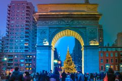Christmas tree with festive people at Washington square downtown Manhattan, NYC, USA royalty free stock photography