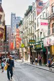 New York City, NY / USA - 08/01/2018: Urban scene in New York City`s Chinatown area of Manhattan, medium shot royalty free stock photos