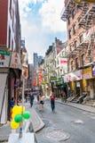 New York City, NY / USA - 08/01/2018: Urban scene in New York City`s Chinatown area of Manhattan, wide shot stock image