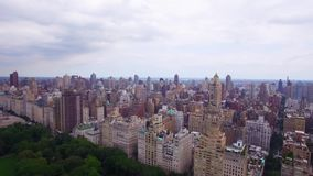 New York City NYC downtown in the day time, central park surronded by amazing modern urban skyscrapers stock video footage