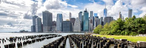 New York City NYC Manhattan skyline panorama view. New York City NYC Manhattan island skyline panorama scenic view. Banner crop of waterfront lifestyle for stock photos