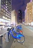 NEW YORK CITY - OCTOBER 23, 2015: Bike rental station at night. Bike rental is a new way to move across the city Stock Photography