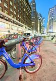 NEW YORK CITY - OCTOBER 23, 2015: Bike rental station at night. Bike rental is a new way to move across the city Royalty Free Stock Photos