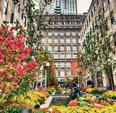 NEW YORK CITY - OCTOBER 24, 2015: Small statues in fountain comp. Osition at Rockefeller Garden. New York attracts 50 million tourists every year Stock Image