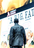 NEW YORK CITY - OCTOBER 24, 2015: Statue of famed showman George. Cohan and huge outdoor billboards promoting Broadway musicals in Times Square Stock Photo