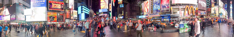 NEW YORK CITY - OCTOBER 2015: Tourists in Times Square at night. Royalty Free Stock Images