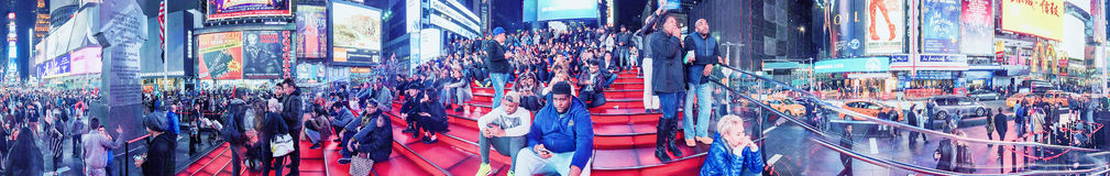 NEW YORK CITY - OCTOBER 2015: Tourists in Times Square at night. Royalty Free Stock Photography