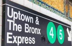 NEW YORK CITY - OCTOBER 24, 2015: Uptown and Bronx subway signs. New York's subway carries close to six million people every day royalty free stock image